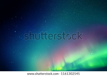 Vector illustration with beautiful starry sky and Northern lights. Abstract colorful background with red-green aurora borealis  #1161302545