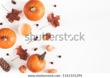 Autumn composition. Pumpkins, candles, dried leaves on white background. Autumn, fall, halloween concept. Flat lay, top view, copy space #1161331294