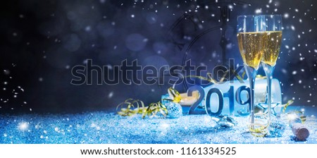 Sparkling New Year background. Champagne Explosion With Toast Of Flutes #1161334525