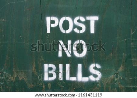post no bills stencil on wooden background
