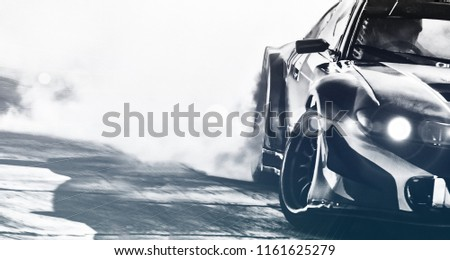 Blurred sport car drifting on speed track. Sport car wheel drifting and smoking with flare effect on track. Sport concept,drifting car concept. #1161625279