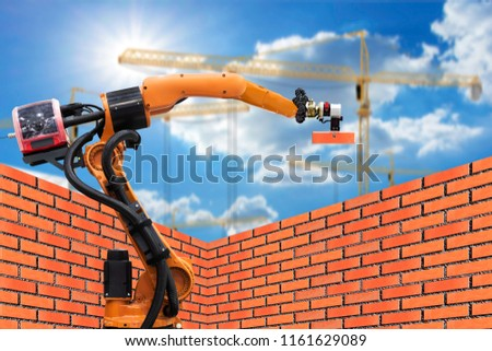 Automatics bricklayer robot working for building brick wall in construction site .concept of robotic technologies in construction industry.