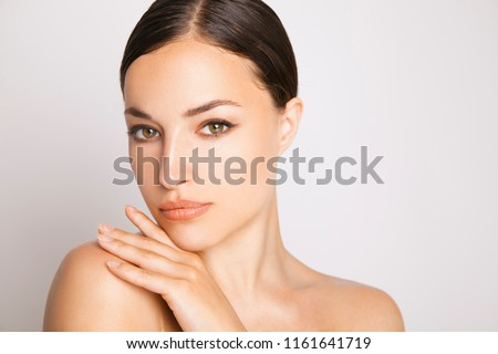 Close up beauty. Beautiful young woman with naturaly makeup and shine healthy skin . Studio shot. Horizontal. White background #1161641719