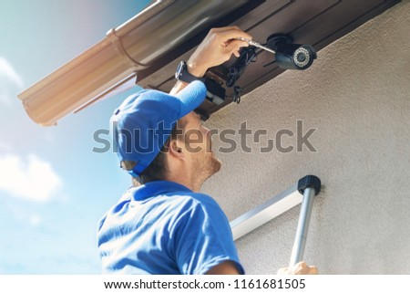 man install outdoor surveillance ip camera for home security #1161681505