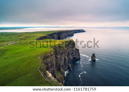 Aerial view of the scenic Cliffs of Moher in Ireland. This popular tourist attraction is situated in County Clare along the Wild Atlantic Way. Royalty-Free Stock Photo #1161781759
