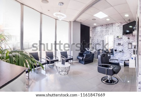 Panorama of a  modern bright beauty salon. Hair salon interior business with black and white luxury decor. Royalty-Free Stock Photo #1161847669