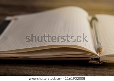 Work and time management, opened notebook over rustic, old textured wooden table. Copy space. #1161932008