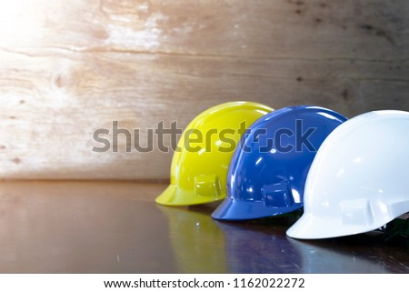 Engineer, electrician and worker 's helmet color as White, Blue and Yellow , PPE  (Personal Protective Equipment) very importance for health protection. Safety at work concept #1162022272