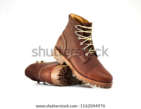 Men's ankle boot with nubuck leather isolated on white background, closed up Royalty-Free Stock Photo #1162044976