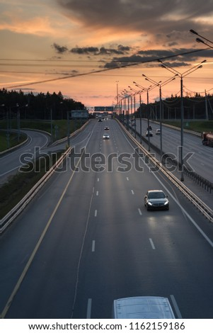 Highway traffic in sunset. minivan on the asphalt road with metal safety barrier or rail. Pine forest on the background #1162159186