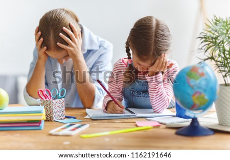 mother scolds a child for poor schooling  and homework at home Royalty-Free Stock Photo #1162191646
