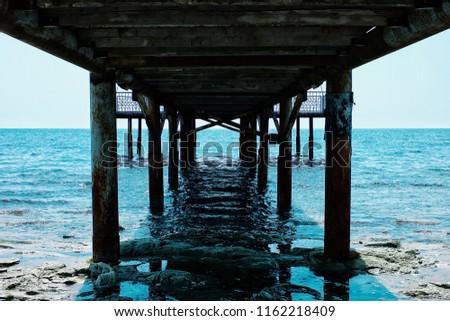 Aktau / Kazakhstan - APR 28 2011: old pier leading to the caspian sea from the desert #1162218409