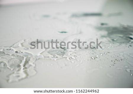 water splashes reflex on the flat glass floor #1162244962
