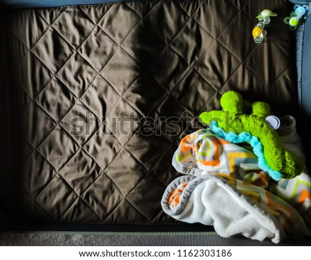 portable crib with infant blanket and stuffed animal #1162303186