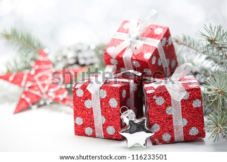 Closeup of gift boxes and pine branch. #116233501
