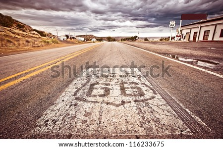 An old Route 66 shield painted on road Royalty-Free Stock Photo #116233675