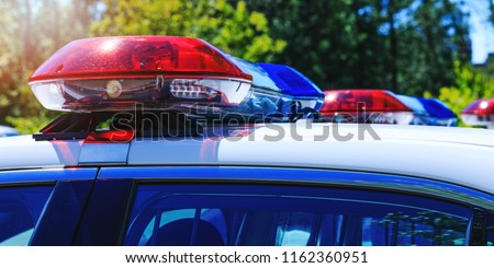 Patrol police car with beautiful emergency sirens lights. Canadian policemen in traffic control activity. A police raid for arrest and stop of crime delinquents. Flashing light on security cars.