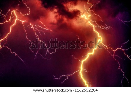 orange thunderstorm night sky