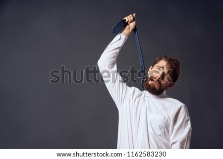 man pulling a tie up problems at work business                              #1162583230