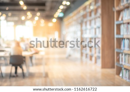 Abstract blurred empty college library interior space. Blurry classroom with bookshelves by defocused effect. use for background or backdrop in book shop business or education resources concepts #1162616722
