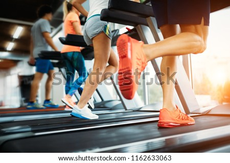 Picture of people running on treadmill in gym #1162633063