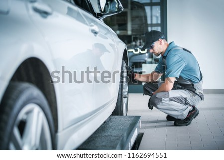 Scheduled Car Service During Vehicle Factory Warranty. Automotive Theme. Caucasian Technician Looking For Potential Issues. #1162694551