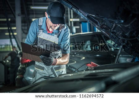 Car Mechanic Detailed Vehicle Inspection. Auto Service Center Theme.  Royalty-Free Stock Photo #1162694572
