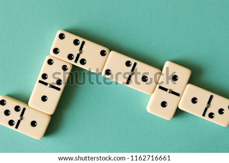 Playing dominoes on a light background . The concept of the game of dominoes. Close up. #1162716661