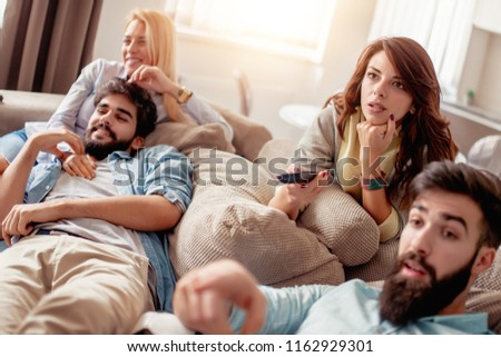 Friends at home watching TV together. #1162929301