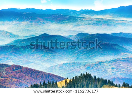 Ranges of mountains and hills at sunset #1162936177