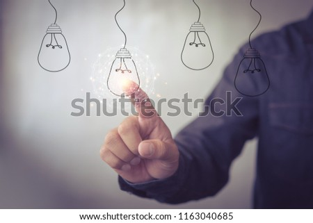 new idea creative idea.Concept of idea and innovation.Hand touch Light bulb #1163040685