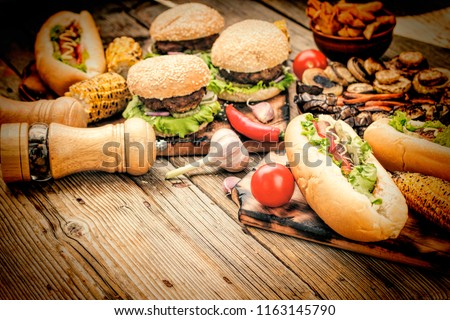 Сoncept: American fast food. Hamburgers, French fries, hot dogs with cola and beer. Food Festival.