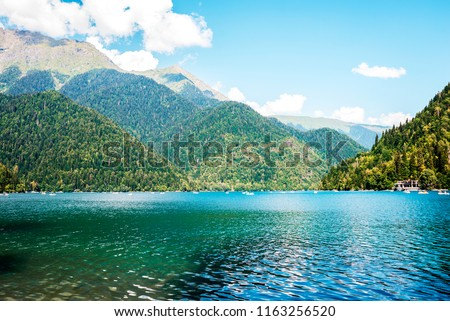 clear blue lake in the mountains #1163256520