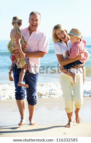 Grandparents And Grandchildren Enjoying Beach Holiday #116332585