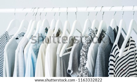 Gray clothing on the hangers #1163332822