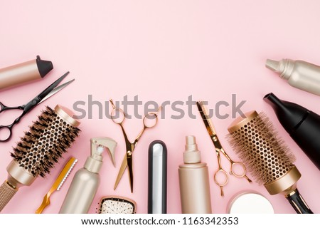 Various hair dresser tools on pink background with copy space #1163342353