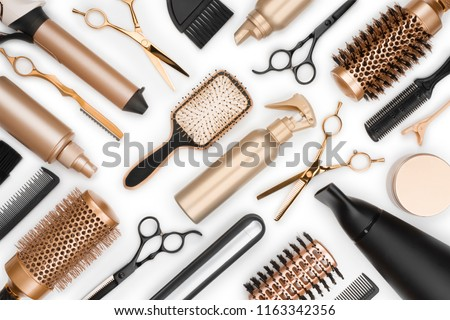 Full frame of professional hair dresser tools on white background #1163342356