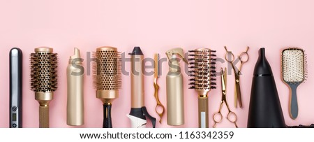 Professional hair dresser tools on pink background with copy space #1163342359