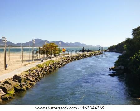 A view of Lagoa da Conceicao and the Atlantic ocean at Barra da Lagoa - Florianopolis, Brazil #1163344369