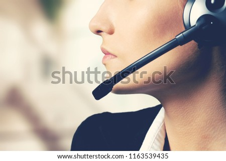 Woman Call Center operator on dark background #1163539435