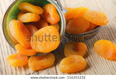 Dried apricots on a wooden table #116355232