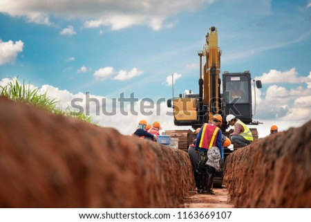 Group of worker and construction engineer wear safety uniform excavation water drainage at construction site #1163669107