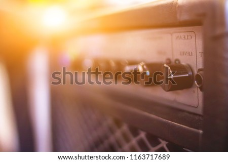 blur photo,A close-up of the power amplifier inside the rehearsal room makes it possible to see the amplifier's power amplifier in a beautiful and classic shape on the background of the sunrise. #1163717689