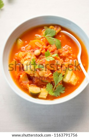 Bowl of vegetable - cauliflower, tomatoes, carrots & fennel soup #1163791756