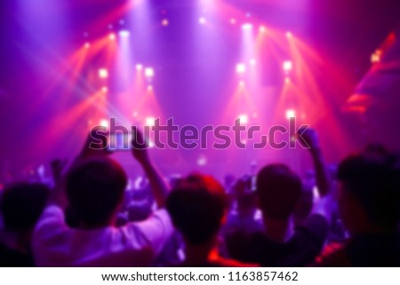 Effects blur Concert, disco dj party. People with hands up having fun #1163857462