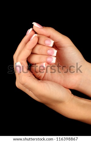 Beautiful woman's hands with french manicure on black background #116398867