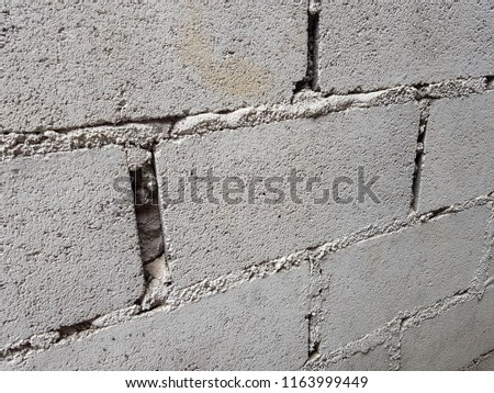 Lightweight Brick without plaster and Unskilled of the technician make a gap mortar between the bricks. #1163999449