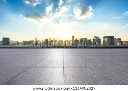 empty square with city skyline #1164002329