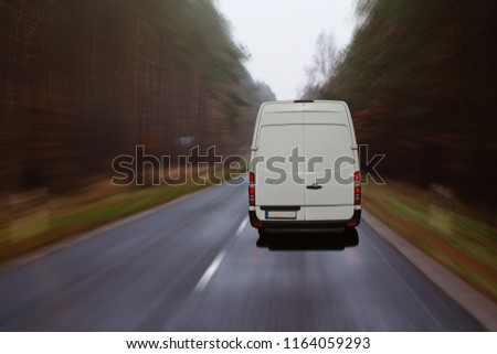 Delivery van driving on a dark road #1164059293
