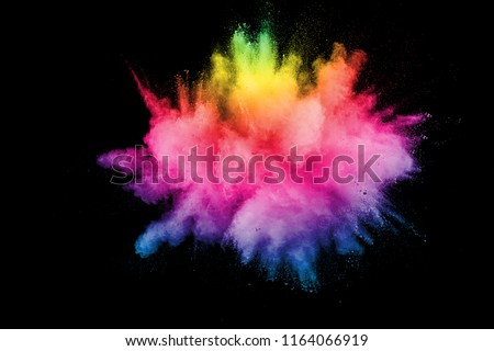 Abstract multicolored powder explosion on black background. Color dust particle splattered on background. #1164066919